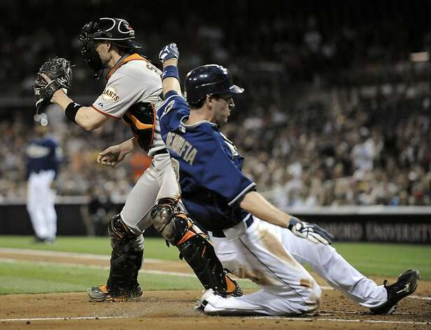 SAN DIEGO, CA - SEPTEMBER 6: Chris Denorfia #13 of the San Diego Padres scores ahead of the tag of Chris Stewart #37 of the San Francisco Giants during the second inning of a baseball game at Petco Park on September 6, 2011 in San Diego, California.  (Photo by Denis Poroy/Getty Images) Photo: Denis Poroy, Getty Images