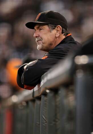 Giants manager Bruce Bochy watches from the dugout, as the San Francisco Giants take on the Arizona Diamondbacks at AT&T Park, in San Francisco, Ca., on Saturday September 3, 2011. Photo: Michael Macor, The Chronicle