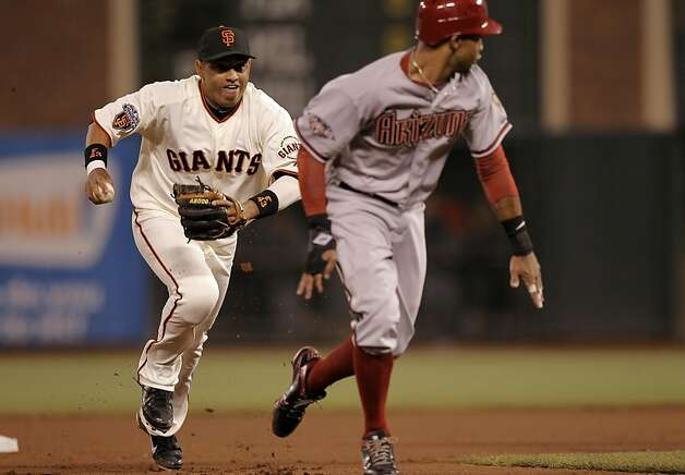 The Giants Orlando Cabrera chases down Dianmaondbacks Chris Young who is caught between second and third base in the ninth inning, as the San Francisco Giants go on lose to the Arizona Diamondbacks 7-2 at AT&T Park, in San Francisco, Ca., on Saturday September 3, 2011. Photo: Michael Macor, The Chronicle