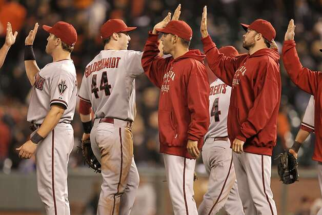The Arizona Diamondbacks celebrate their win over the San Francisco Giants with a score of 7-2 at AT&T Park, in San Francisco, Ca., on Saturday September 3, 2011. Photo: Michael Macor, The Chronicle