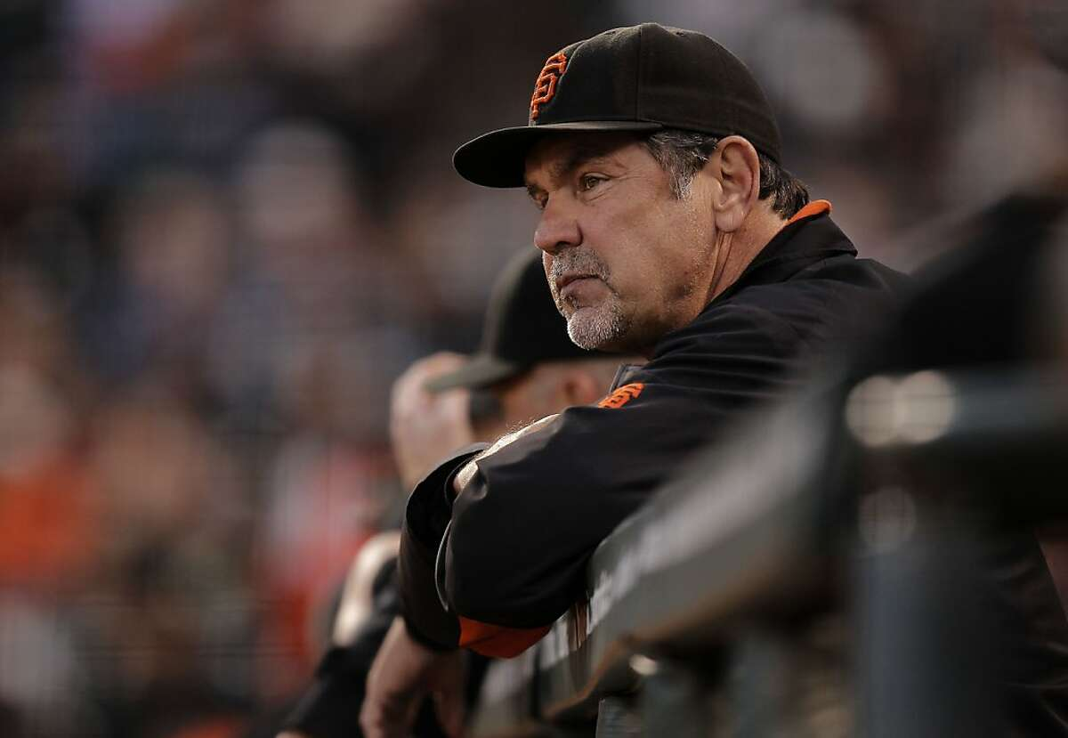 Giants manager Bruce Bochy watches from the dugout, as the San Francisco Giants take on the Arizona Diamondbacks at AT&T Park, in San Francisco, Ca., on Saturday September 3, 2011.