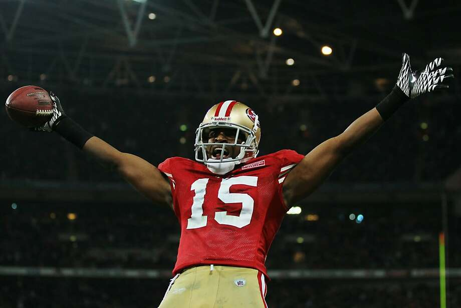 LONDON, ENGLAND - OCTOBER 31:  Michael Crabtree #15 of San Francisco 49ers celebrates as he scores their second touchdown during the NFL International Series match between Denver Broncos and San Francisco 49ers at Wembley Stadium on October 31, 2010 in London, England. This is the fourth occasion where a regular season NFL match has been played in London.  (Photo by Chris McGrath/Getty Images)  Ran on: 11-07-2010 Wide receiver Michael Crabtree celebrates as he scores a touchdown last week in London against the Broncos, to help deliver the team's second win of the year. Ran on: 11-08-2010 Michael Crabtree celebrated a touchdown against the Broncos on Oct. 31 as the 49ers picked up their second win. Photo: Chris McGrath, Getty Images