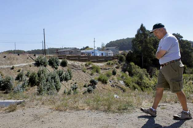 Resident Alan Esola walks along the blast site, where a park and homes once stood before last years PG&E explosion,  Tuesday September 6, 2011,  in San Bruno, Calif. This was the first time for many of the residents to see the site from this angle, so it brought up many emotions from the last year. Photo: Lacy Atkins, The Chronicle
