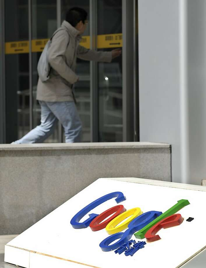 A man walks near the Google company logo outside the Google China headquarters in Beijing on March 21, 2010. Chinese media unleashed a torrent of criticism against Google after reports it would leave the country, with state news agency Xinhua alleging the company was linked to US intelligence.  AFP PHOTO/ LIU Jin (Photo credit should read LIU JIN/AFP/Getty Images)  Ran on: 03-22-2010 Google is still operating in China, but some reports say it will pull out next month. The company decided to stop censoring search results after it was hacked.  Ran on: 04-23-2010 Photo caption Dummy text goes here. Dummy text goes here. Dummy text goes here. Dummy text goes here. Dummy text goes here. Dummy text goes here. Dummy text goes here. Dummy text goes here.###Photo: sector23_google_PH1269043200AFP###Live Caption:A man walks near the Google company logo outside the Google China headquarters in Beijing on March 21, 2010. Chinese media unleashed a torrent of criticism against Google after reports it would leave the country, with state news agency Xinhua alleging thecompany was linked to US intelligence.###Caption History:A man walks near the Google company logo outside the Google China headquarters in Beijing on March 21, 2010. Chinese media unleashed a torrent of criticism against Google after reports it would leave the country, with state news agency Xinhua alleging the company was linked to US intelligence.  AFP PHOTO- LIU Jin (Photo credit should read LIU JIN-AFP-Getty Images)____Ran on: 03-22-2010__Google is still operating in China, but some reports say it will pull out next month. The company decided to stop censoring search results after it was hacked.###Notes:###Special Instructions: Photo: Liu Jin, AFP/Getty Images