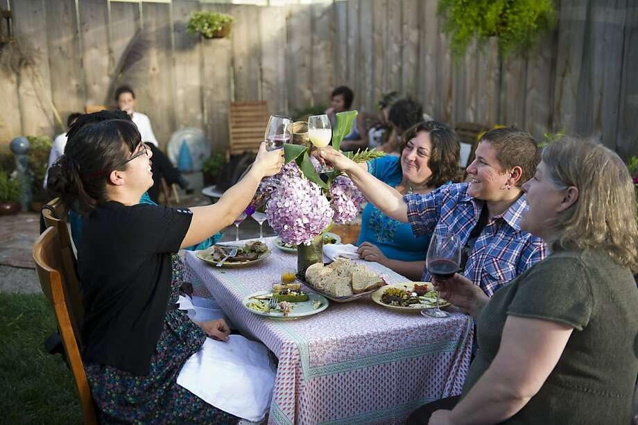 Kim Di Giacomo (C) and  Michele Senitzer (2ndR) toast Jamie Vasta (L), Oletta Reed (2nd L) and Kitty Sharkey (R) during a found food feast on August 21, 2011 in Oakland, Calif. Photograph by David Paul Morris/Special to the Chronicle Photo: David Paul Morris, Special To The Chronicle