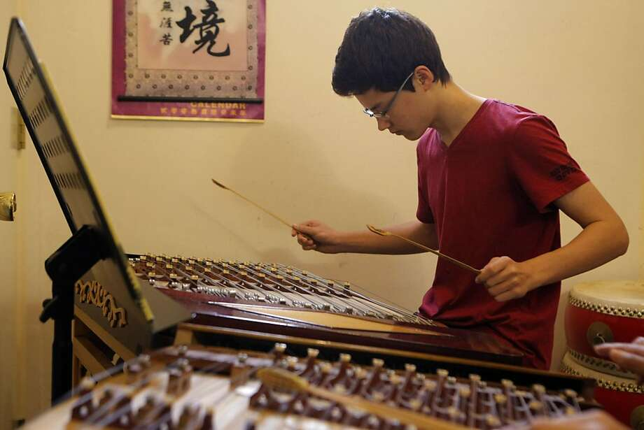 Sixteen-year-old Reylon Yount, a Davidson Fellow, plays the yangqin during his lesson at the Chinese Arts and Music Center in San Francisco Calif., on September 3, 2011.  Yount has been playing the yangqin for eight years and says he still loves to play. Photo: Audrey Whitmeyer-Weathers, The Chronicle