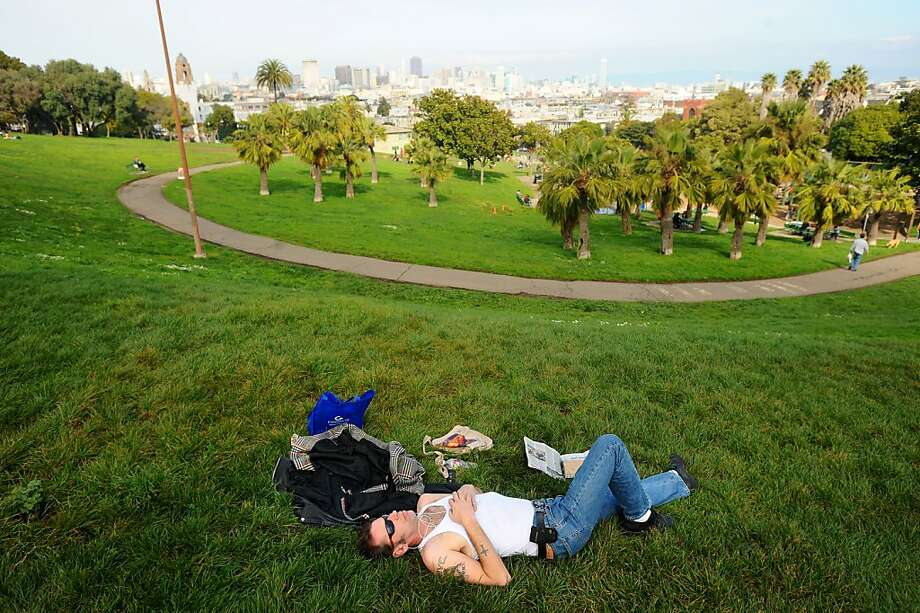 Sean Swanson relaxes in Dolores Park on Saturday, Feb. 13, 2010, in San Francisco. The park is slated to close for renovations.  Ran on: 02-19-2010 Visitors to Mission Dolores Park like Sean Swanson, who relaxed there Saturday, may find the park open during extensive construction work that was set to close the park. Photo: Noah Berger, Special To The Chronicle