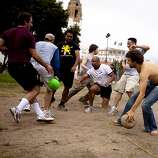 James Ream, right, of Wisconsin, rushes to pick up a rubber ball as teammates and opponents begins to play a game of dodgeball at Dolores Park in the Mission District in San Francisco, Calif. on Sunday, Aug. 30, 2009. Once an area inhabited by American Indians, Dolores Park have since seen various uses from being a cemetery in the 19th century, to refugee camps for the victims of the 1906 earthquakes, to what it current today as a leisure park coupled with playgrounds and tennis courts. The group is part of the San Francisco Dodgeball Meetup group from popular website meetup.com.  Ran on: 09-25-2009 Photo caption Dummy text goes here. Dummy text goes here. Dummy text goes here. Dummy text goes here. Dummy text goes here. Dummy text goes here. Dummy text goes here. Dummy text goes here.###Photo: MISSION25_ph31251331200SFC###Live Caption:James Ream, right, of Wisconsin, rushes to pick up a rubber ball as teammates and opponents begins to play a game of dodgeball at Dolores Park in the Mission District in San Francisco, Calif. on Sunday, Aug. 30, 2009. Once an area inhabited by American Indians, Dolores Park have since seen various uses from being a cemetery in the 19th century, to refugee camps for the victims of the 1906 earthquakes, to what it current today as a leisure park coupled with playgrounds and tennis courts. The group is part of the San Francisco Dodgeball Meetup group from popular website meetup.com.###Caption History:James Ream, right, of Wisconsin, rushes to pick up a rubber ball as teammates and opponents begins to play a game of dodgeball at Dolores Park in the Mission District in San Francisco, Calif. on Sunday, Aug. 30, 2009. Once an area inhabited by American Indians, Dolores Park have since seen various uses from being a cemetery in the 19th century, to refugee camps for the victims of the 1906 earthquakes, to what it current today as a leisure park coupled with playgrounds and tenni