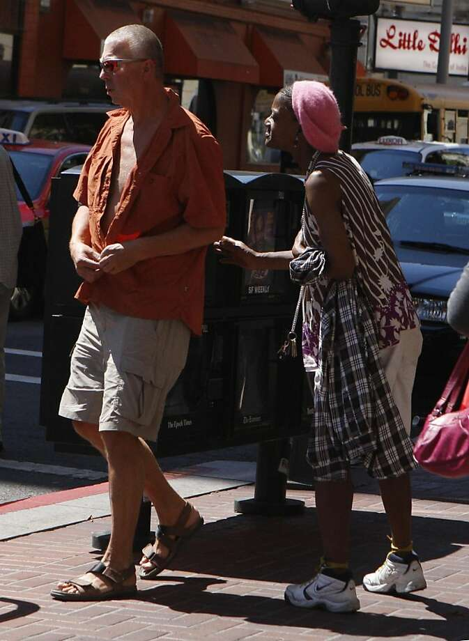 A woman asks for change near Market Street in San Francisco, Calif. on Wednesday, Sept. 7, 2011. Photo: Dylan Entelis, The Chronicle