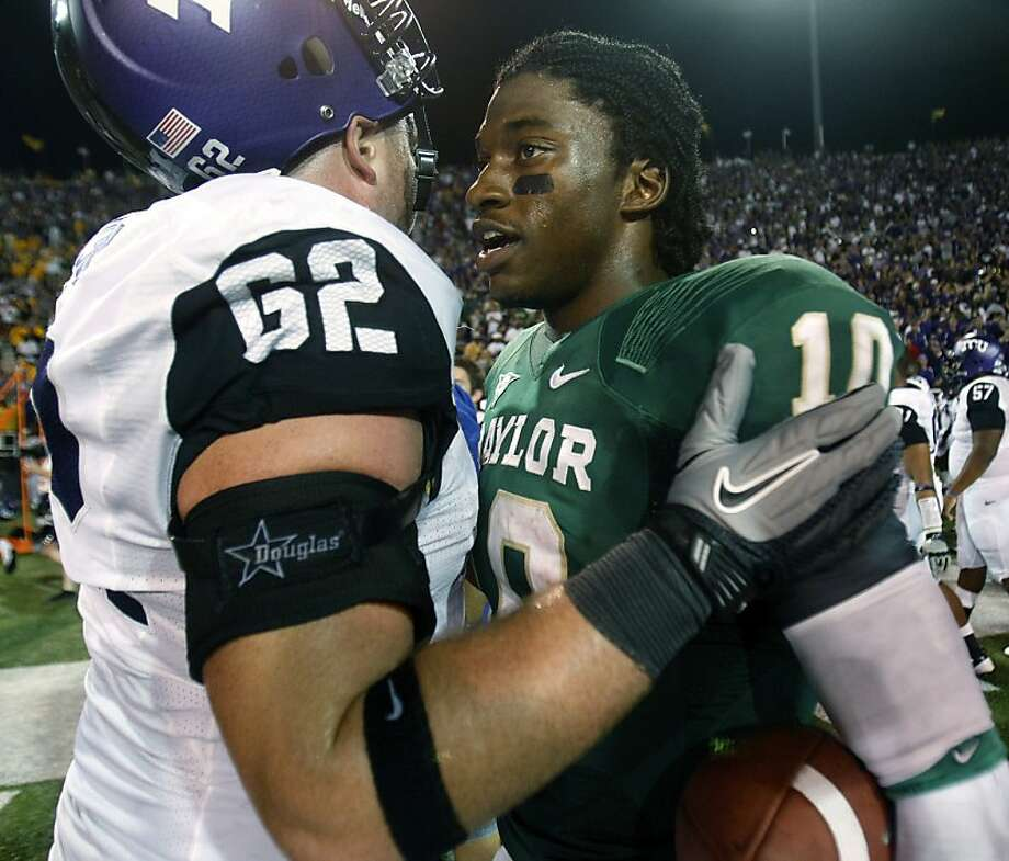 Baylor quarterback Robert Griffin III (10) and TCU offensive tackle Jeff Olson (62) talk after their NCAA college football game in Waco, Texas, Friday, Sept. 2, 2011. Baylor won 50-48.  (AP Photo/LM Otero) Photo: LM Otero, AP