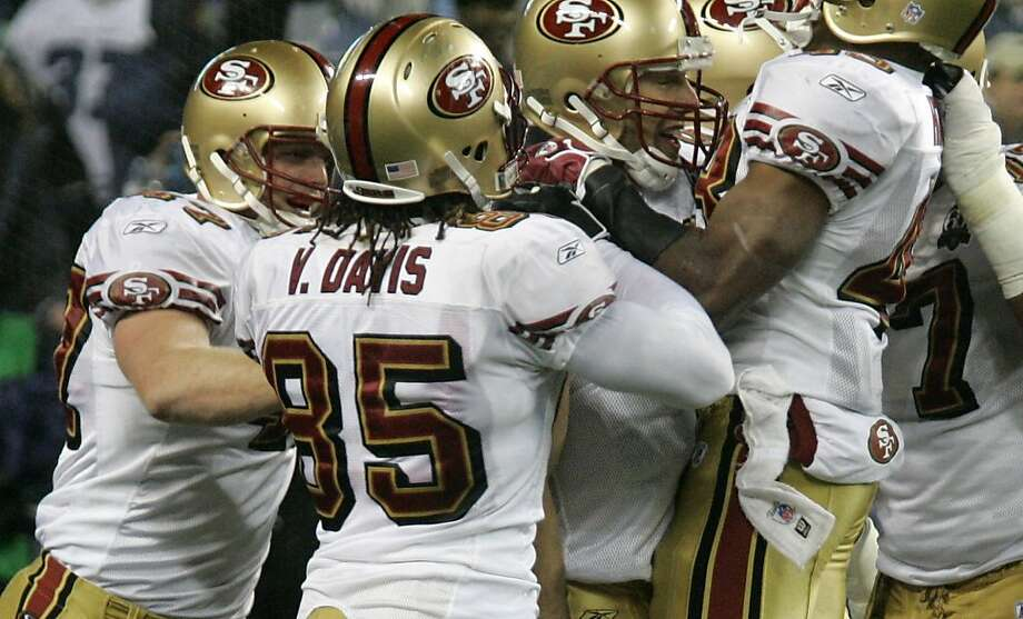 San Francisco 49ers' Vernon Davis and other players mob 49ers quarterback Alex Smith, third from left, after a 49ers touchdown in the fourth quarter Thursday, Dec. 14, 2006, at Qwest Field in Seattle. San Francisco beat the Seahawks, 24-14. (AP Photo/Ted S. Warren)  Ran on: 09-07-2011 Tight end Vernon Davis and other 49ers teammates mobbed quarterback Alex Smith after one of the team's three fourth-quarter touchdowns in a 24-14  victory at Seattle five years ago. Briefly, he looked like a worthy heir to Joe Montana and Steve Young. Photo: Ted S. Warren, AP