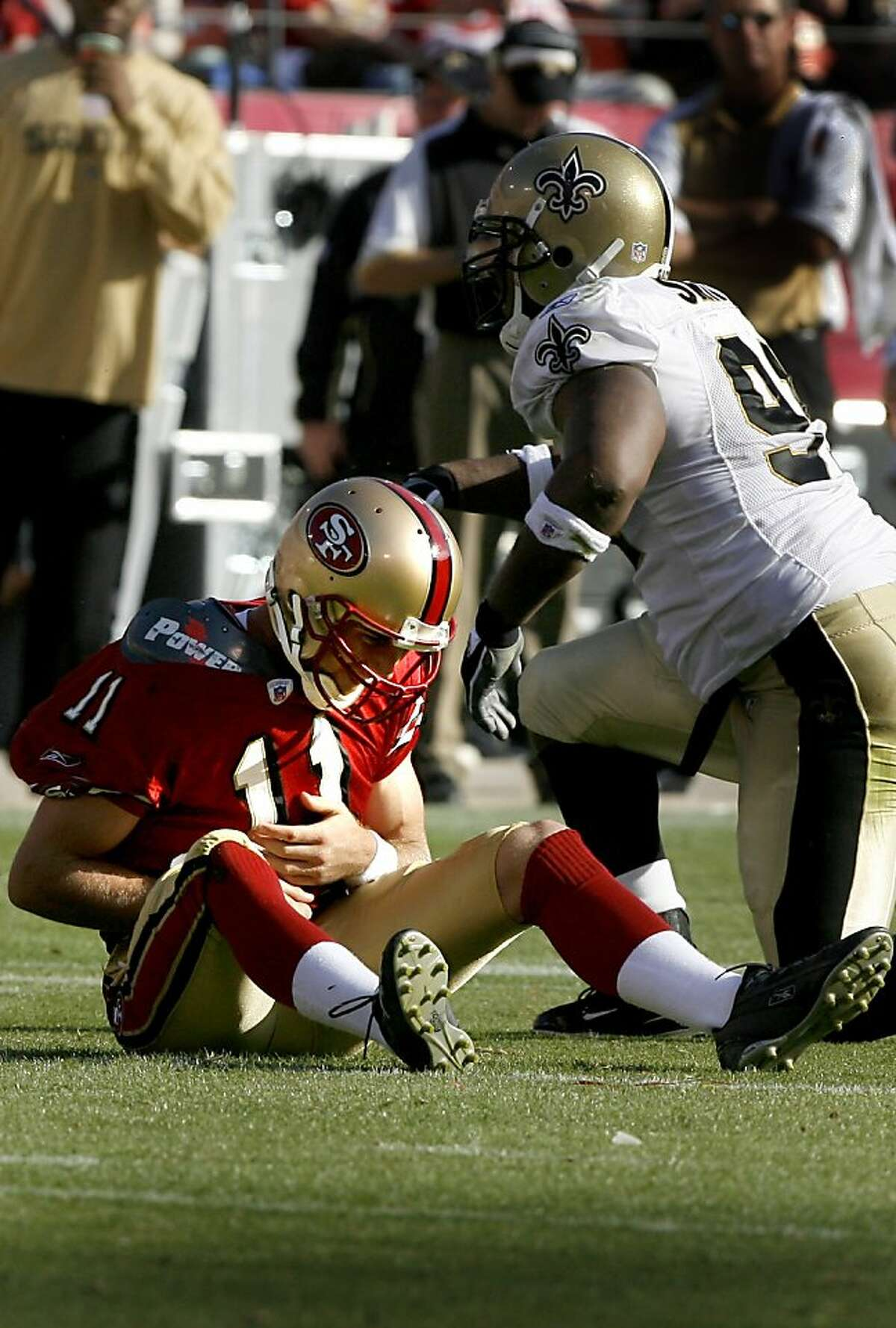 49ers_099.JPG 49ers quarterback Alex Smith got up slowly after being sacked by DE Will Smith in 2nd half. Game action at Monster Park between San Francisco 49ers and New Orleans Saints Sunday. The Saints won 30-10. {By Brant Ward/San Francisco Chronicle}10/28/07 Ran on: 10-29-2007 Smith would get up slowly after this sack by New Orleans' Will Smith in the fourth quarter. Ran on: 10-29-2007 Smith would get up slowly after this sack by New Orleans' Will Smith in the second quarter. Ran on: 10-29-2007 Ran on: 09-07-2011 Smith, with an injured shoulder, had that rundown feeling against the Saints.
