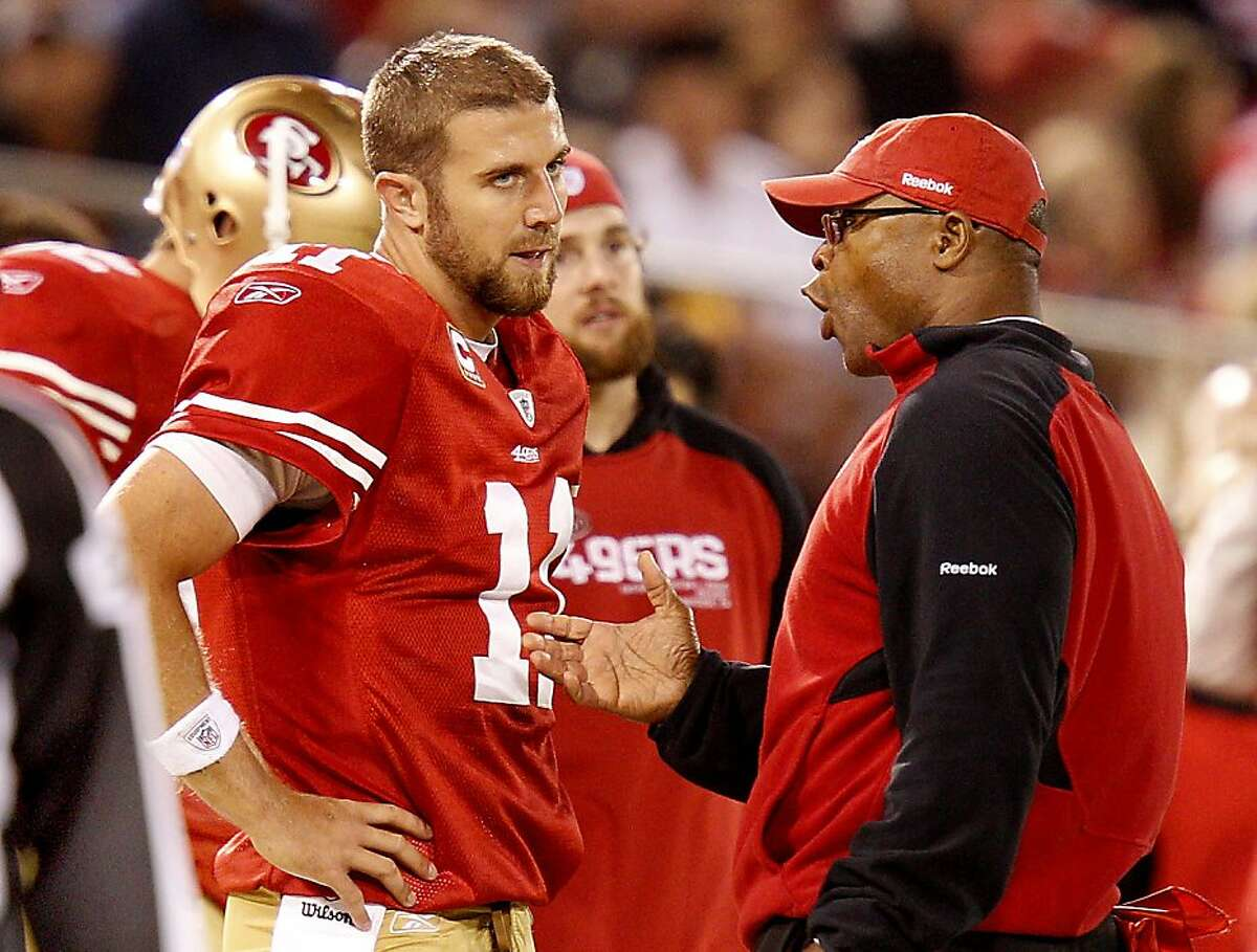 San Francisco 49ers quarterback Alex Smith and head coach Mike Singletary have a discussion on the sidelines, during the Philadelphia Eagles game, after Smith's fumble led to an Eagle score.