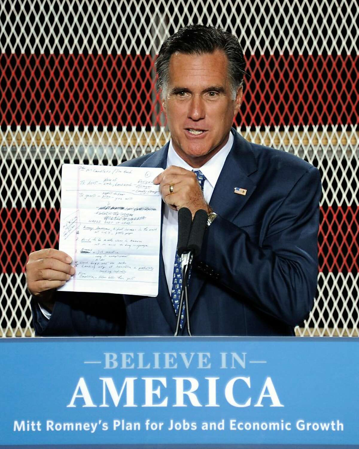 NORTH LAS VEGAS, NV - SEPTEMBER 06: Former Massachusetts Gov. and Republican presidential hopeful Mitt Romney holds up his notes as he speaks about his plan to increase jobs and boost the U.S. economy at McCandless International Trucks, Inc. September 6, 2011 in North Las Vegas, Nevada. Romney, who won the GOP presidential caucuses in Nevada in 2008, is introducing his plan two days ahead of President Barack Obama's scheduled jobs proposal speech to Congress. (Photo by Ethan Miller/Getty Images)