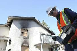 PG&E Representative Mike Jacobs inspect an underground gas line following a fire caused by a gas leak that destroyed a neighboring townhome  the night before on Thursday, September 1, 2011 in Cupertino, Calif.