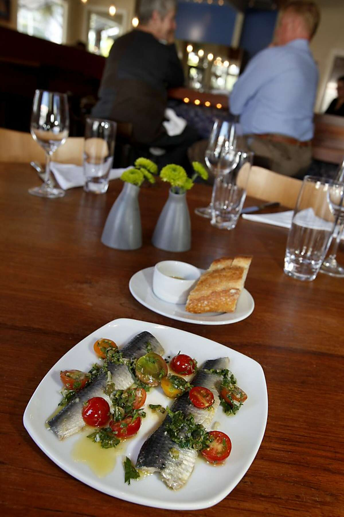 Marinated sardines with salsa verde and cherry tomato at Coco500 on Brannan Street in San Francisco, Calif.