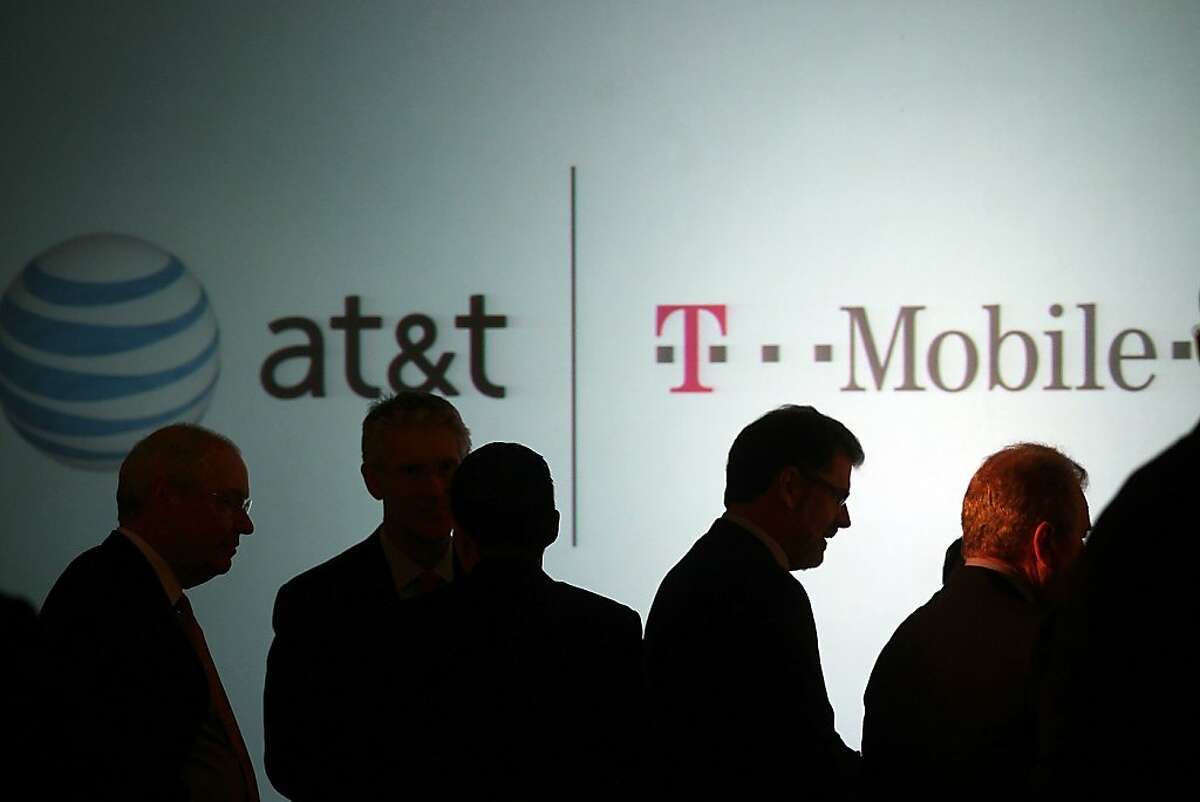 NEW YORK, NY - MARCH 21: Executives at AT&T attend a news conference where it was announced that AT&T Inc. will be buying its wireless rival T-Mobile USA from Deutsche Telekom AG for $39 billion in cash and stock on March 21, 2011 in New York City. The deal, which will be scrutinized by U.S. regulators, would create the nation's largest wireless carrier if approved. The deal would likely result in domestic job cuts. T-Mobile USA employs about 38,000 people while AT&T employs an estimated 267,000 people. (Photo by Spencer Platt/Getty Images) Ran on: 03-22-2011 Executives at AT&T attend a news conference where it was announced that AT&T Inc. will be buying wireless rival T-Mobile USA from Deutsche Telekom for $39 billion in cash and stock.