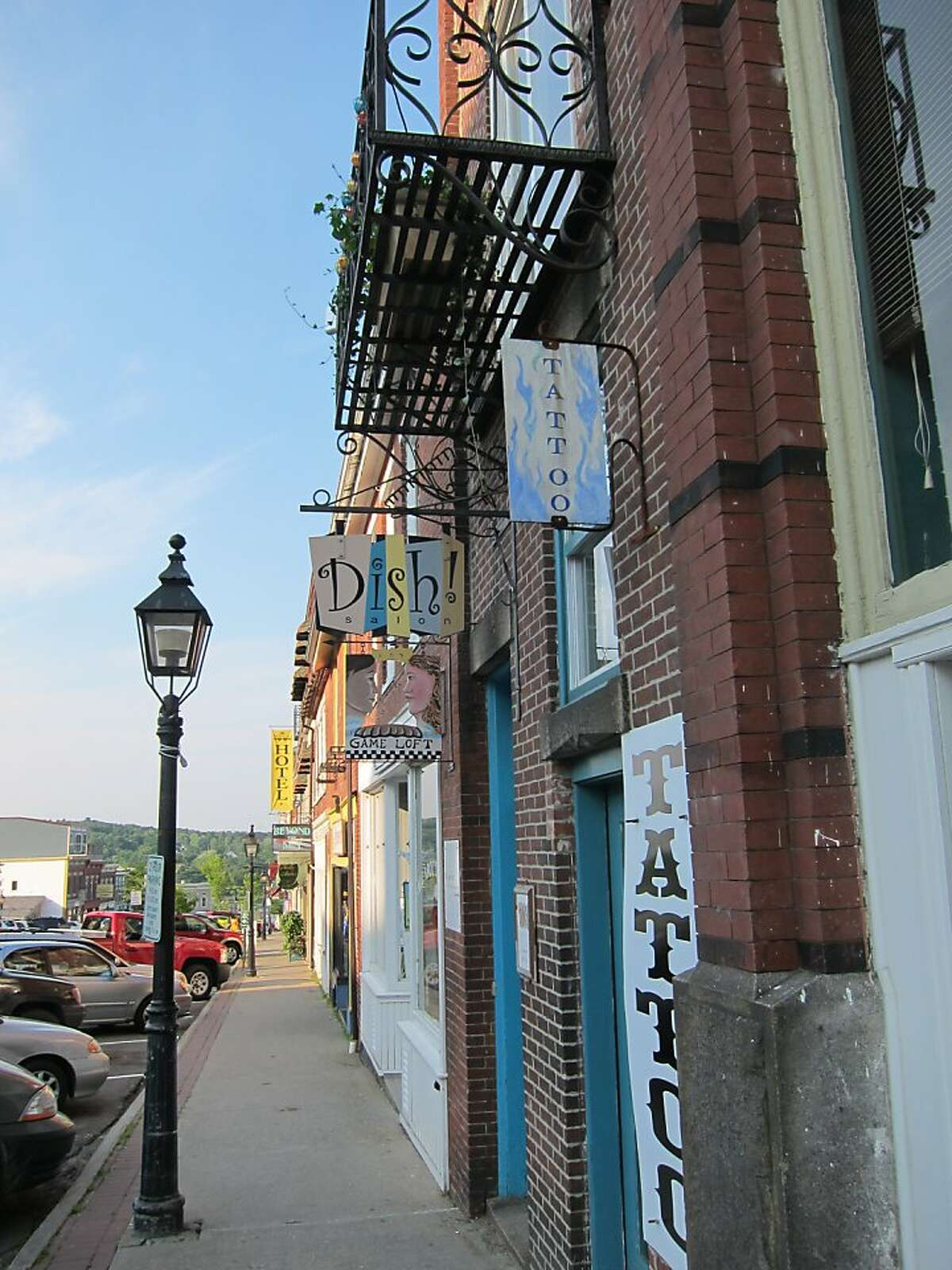 Belfast's lively downtown teems with galleries, boutiques and cafes in stately preserved buildings, as seen here on Main Street, which slopes down to the harbor. The emphasis is on local-made.