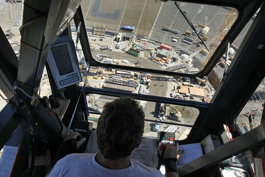 Kirk Luba sits in the catbird seat of one of four Tower Cranes working two hundred feet above the stadium floor and working for Webcor Construction the leading contractor renovation UC BerkleyÕs Memorial Stadium lifts materials to waiting workers Wednesday August 24, 2011. Photo: Lance Iversen, The Chronicle