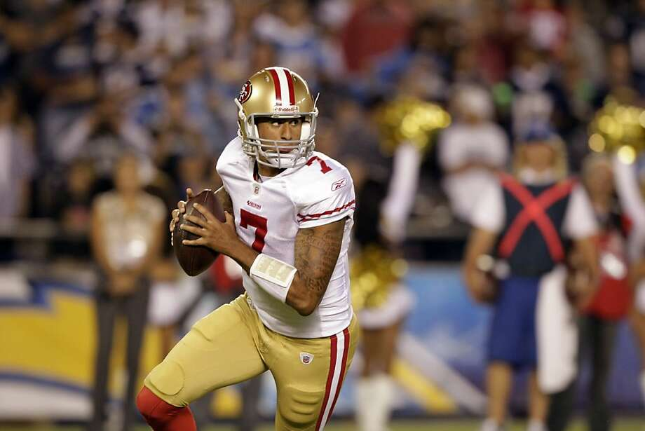 San Francisco 49ers quarterback Colin Kaepernick scrambles against the San Diego Chargers during the second half in an NFL preaseason football game Thursday, Sept. 1, 2011, in San Diego. (AP Photo/Gregory Bull) Photo: Gregory Bull, AP