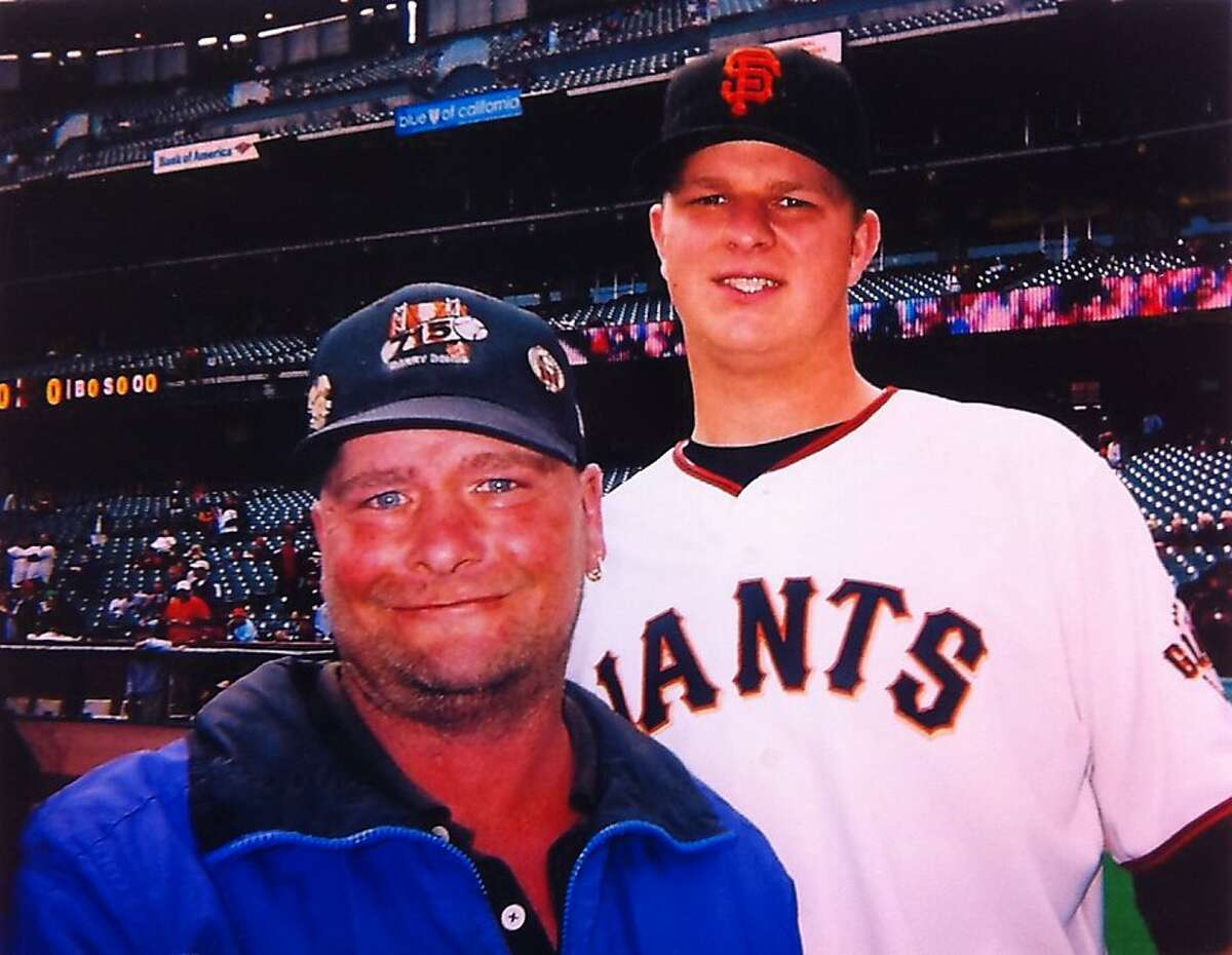 A photograph of Giants pitcher Matt Cain with Billy Chamberlain, a fan who had been missing for more than a month, is taped to the water cooler cart in the Giants dugout, Saturday September 3, 2011, at AT&T Park, in San Francisco, Ca.