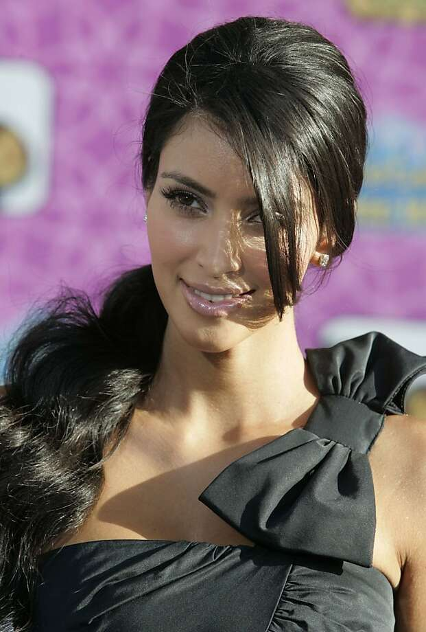 """Reality television star Kim Kardashian arrives as a guest at the premiere of the Disney Channel movie """"The Cheetah Girls One World""""  in Hollywood  August 12, 2008.  REUTERS/Fred Prouser       (UNITED STATES) Ran on: 08-26-2008 Reality TV star Kim Kardashian and former Oakland Raider Warren Sapp will compete during the new season of &quo;Dancing With the Stars.&quo; Photo: Fred Prouser, REUTERS"""