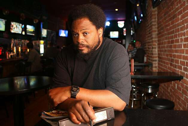 Bartender Orlando Green at The Union Square Sports Bar in San Francisco, Ca.,  on Monday, September 5, 2011, as he shows where he was sitting across from Billy Chamberlain when he last saw him.  Orlando Green has given Billy, a semi-homeless man who is missing, a place to sleep for the last 5 years. Photo: Liz Hafalia, The Chronicle
