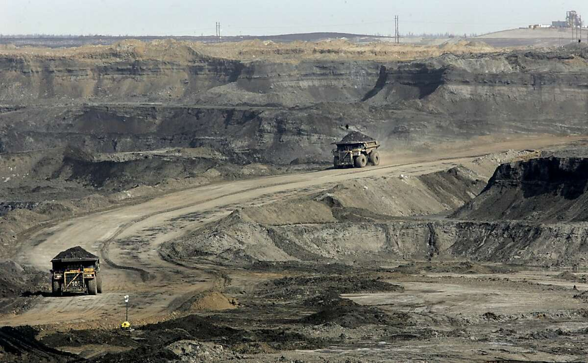 ft_mcmurray751_ward.jpg At the Chevron oilsands project north of Fort McMurray, giant earth haulers drive into the canyon created by the strip mining process. They work 24 hours a day carrying the raw dirt coated with oilsands out of the manmade canyon. The oil sands area of Alberta, Canada is perhaps the answer to Canada and America's energy needs for the next 40 years. The oil is attached to tiny grains of sand and dirt and is being mined all around the city of Fort McMurray. This has caused a