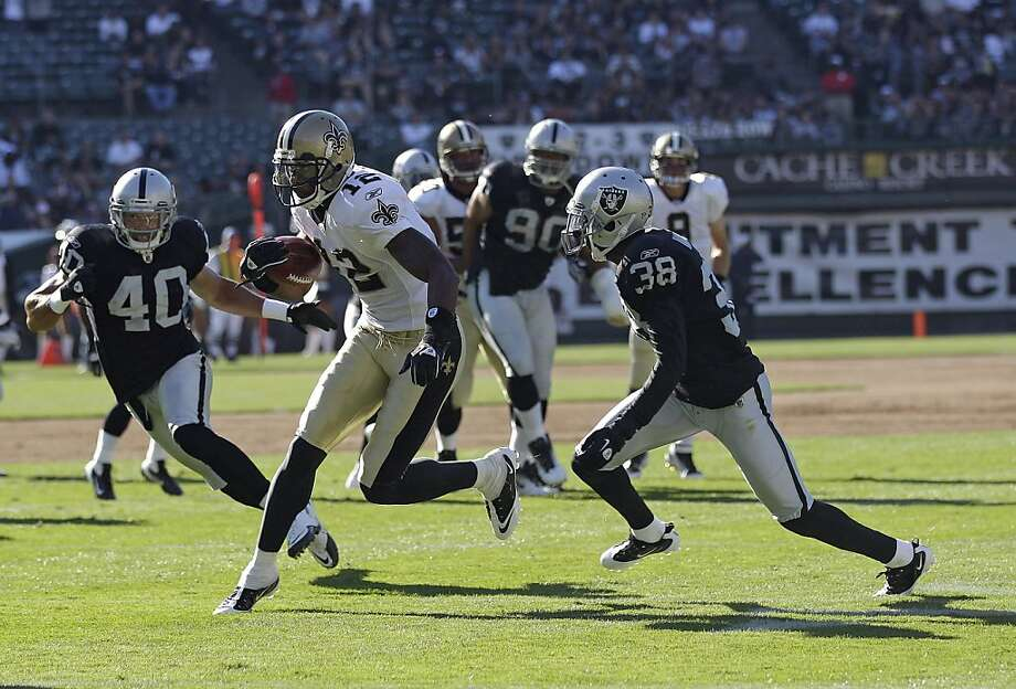 New Orleans Saints wide receiver Marques Colston (12) runs against Oakland Raiders safety Jerome Boyd (40) and cornerback DeMarcus Van Dyke (38) in a preseason NFL football game in Oakland, Calif., Sunday, Aug. 28, 2011. (AP Photo/Marcio Jose Sanchez) Photo: Marcio Jose Sanchez, AP
