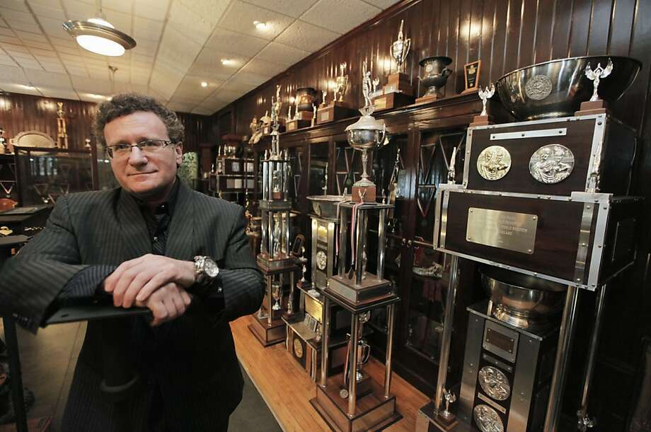 """In this Aug. 9, 2011 photo, Dr. Robert Goldman, one of the co-founders of the American Academy of Anti-Aging Medicine, is photographed in his trophy room in Chicago with hardware from 20 Guinness World Records for strength and endurance. """"People should be healthy and strong well into 100 to 120 years of age,"""" Goldman says in a biographical video. """"That's what's really exciting - to live in a time period when the impossible is truly possible."""" (AP Photo/M. Spencer Green) Photo: M. Spencer Green, AP"""