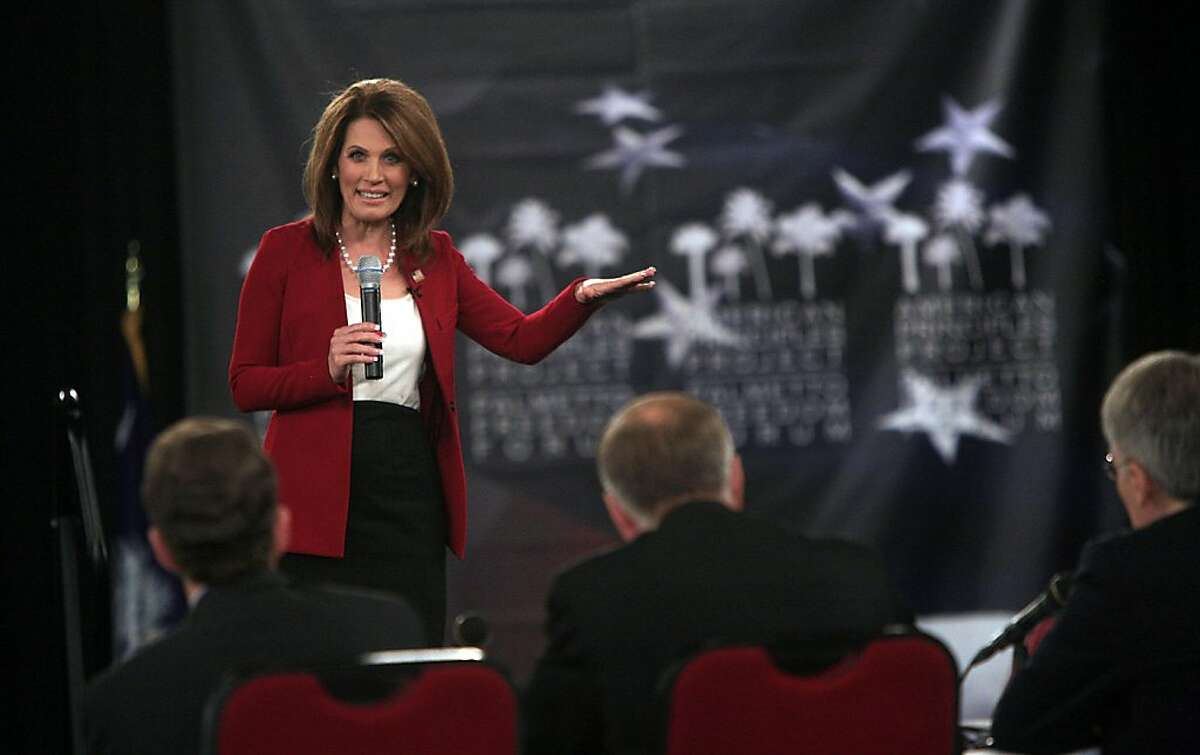 Presidential candidate Michelle Bachmann takes the stage during a Labor Day question and answer forum at the Columbia Metropolitican Convention Center in Columbia, South Carolina, Monday, September 5, 2011. Other Republican candidates included Hernan Cain, Newt Gingrich, Ron Paul and Mitt Romney. (Kim Kim Foster-Tobin/The State/MCT)