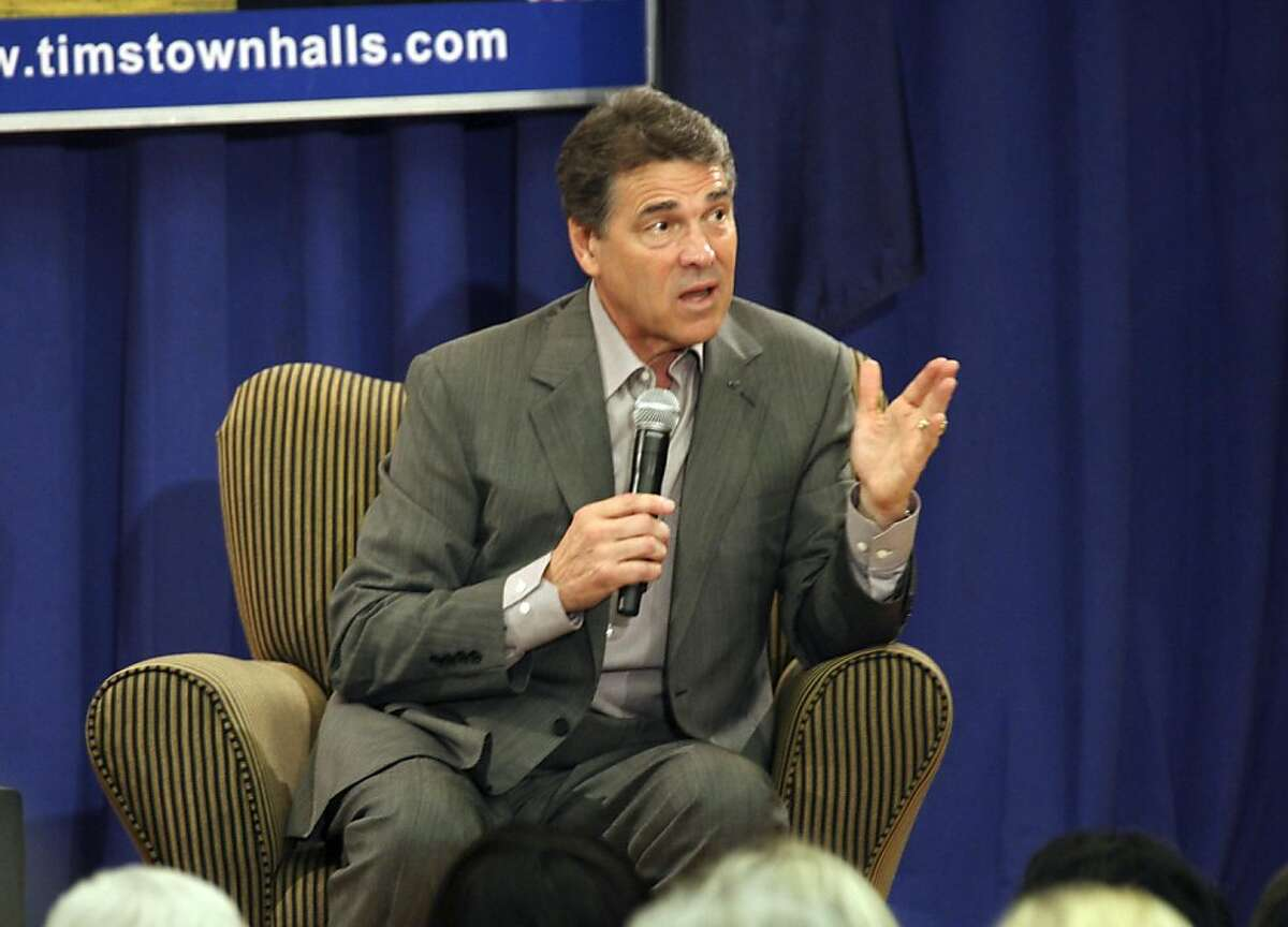 Texas Govenor and Presidential hopeful Rick Perry, speaks to supporters during a town hall meeting hosted by Rep. Tim Scott, R-S.C., at Horry-Georgetown Technical College on Monday Sept. 5, 2011 in Conway, S.C. (AP Photo/Willis Glassgow)