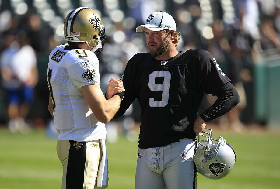 New Orleans Saints quarterback Drew Brees (9) and Oakland Raiders punter Shane Lechler (9) before a preseason NFL football game in Oakland, Calif., Sunday, Aug. 28, 2011. (AP Photo/Marcio Jose Sanchez) Photo: Marcio Jose Sanchez, AP
