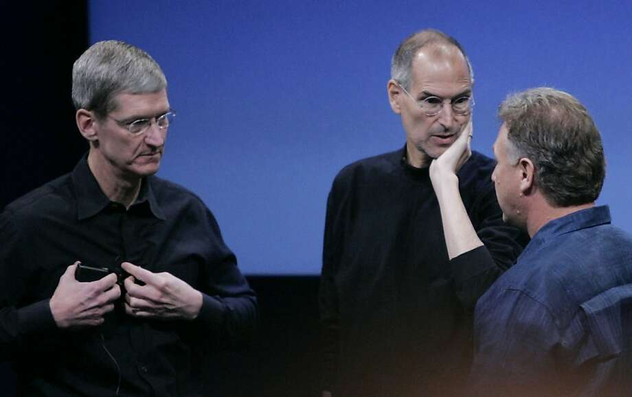 In this Oct. 14, 2008 photo, Apple's chief operating officer, Tim Cook, left, is seen with CEO Steve Jobs, center, and Vice President Phil Schiller, right, during meeting at Apple headquarter in Cupertino, Calif.  Cook takes over as CEO for Apple after Jobs resigned. (AP Photo/Paul Sakuma) Photo: Paul Sakuma, AP