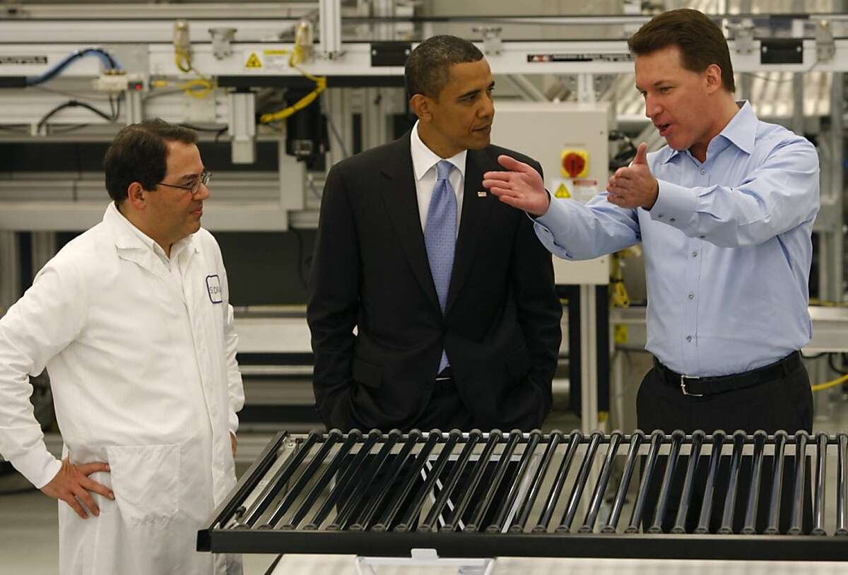 Ben Bierman (left) and Chris Gronet (right) expalin solar technology to President Obama on a tour of the Solyndra solar panel company in Fremont, Calif., on Wednesday, May 26, 2010.