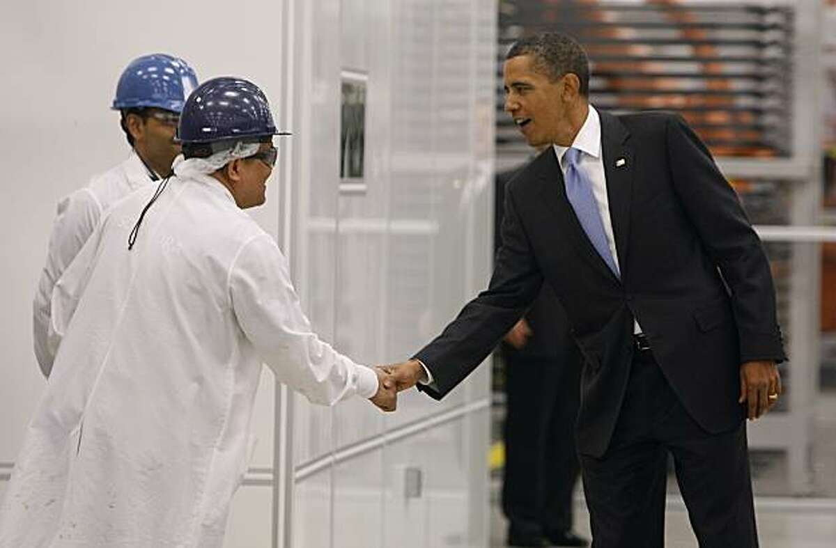 President Obama meets with employees during a tour of the Solyndra solar panel company in Fremont, Calif., on Wednesday, May 26, 2010.