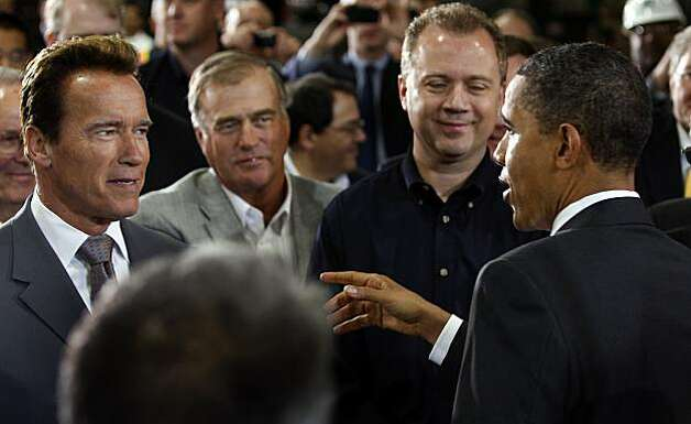 Gov. Arnold Schwarzenegger chats with President Obama after Obama's tour and speech at the Solyndra solar panel company in Fremont, Calif., on Wednesday, May 26, 2010. Photo: Paul Chinn, The Chronicle