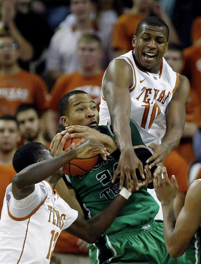 North Texas' Kedrick Hogans (center) is defend by Texas' Myck Kabongo (left) and Jonathan Holmes (right) during the second half of an NCAA college basketball game, Tuesday, Nov. 29, 2011, in Austin. Photo: Eric Gay, Associated Press / AP