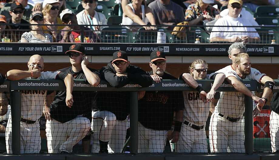 San Francisco Giants players and coaches watch from the dugout in the ninth inning of a baseball game against the Arizona Diamondbacks in San Francisco, Sunday, Sept. 4, 2011. The Diamondbacks won 4-1. (AP Photo/Jeff Chiu) Photo: Jeff Chiu, AP