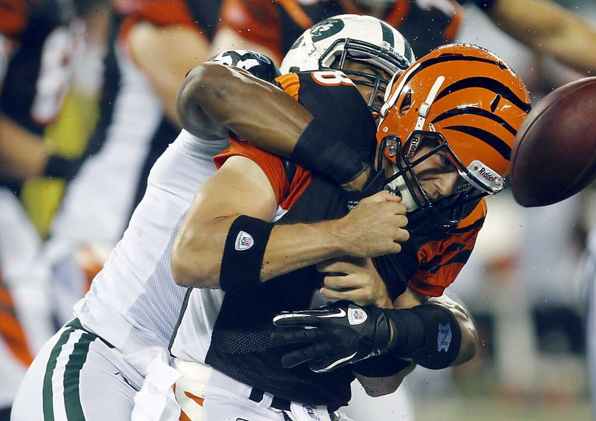 New York Jets Aaron Maybin, left, sacks Cincinnati Bengals quarterback Dan LeFevour during the fourth quarter of an NFL preseason football game, Sunday, Aug. 21, 2011, in East Rutherford, N.J. The Jets won the game 27-7. (AP Photo/Julio Cortez)