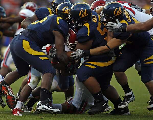 Fresno State Robbie Rouse (8) is gang tackled by Cal's defense in the fourth quarter of their season opener played at San Francisco's Candlestick Park Saturday September 3, 2011. Photo: Lance Iversen, The Chronicle