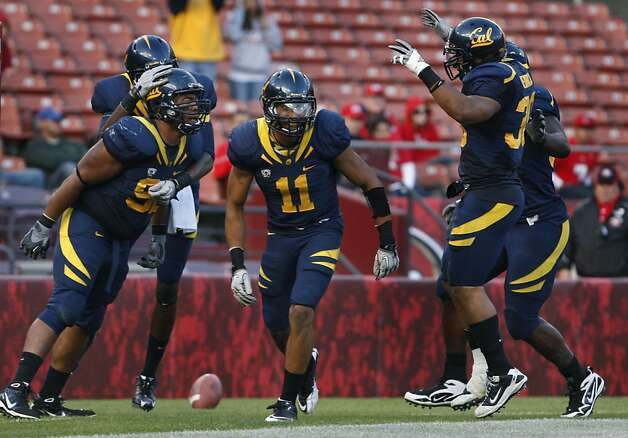California Defensive-end Trevor Guyton (92) left celebrates his touchdown on a Fresno State interception in the third quarter with his teammates at San Francisco's Candlestick Park Saturday September 3, 2011. Photo: Lance Iversen, The Chronicle