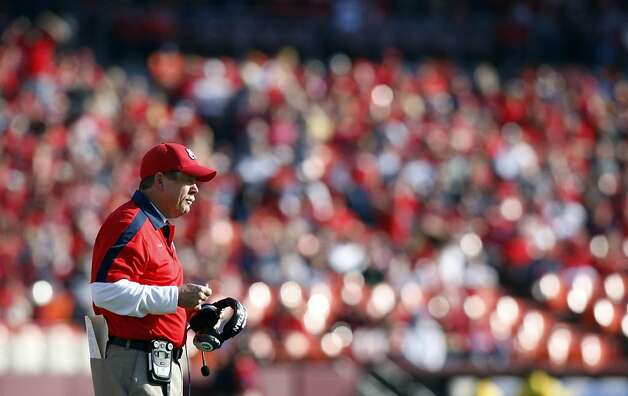 Fresno State head coach Pat Hill calls in plays from the sideline during their game with the University of California played at San Francisco's Candlestick Park Saturday September 3, 2011. Cal defeated Fresno 36-14 in their season opener. Photo: Lance Iversen, The Chronicle