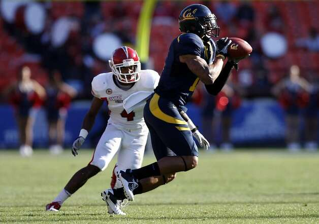 Cal's Michael Calvin (11) catches a Zach Maynard pass in front of Fresno State L.J. Jones (4) late into the 2nd quarter of their football game played at San Francisco's Candlestick Park Saturday September 3, 2011. Photo: Lance Iversen, The Chronicle