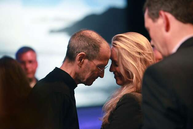 Steve Jobs, Apple CEO, leans his forehead against his wife, Laurene Powell Jobs, forehead after delivering the keynote address to the Apple Worldwide Developers Conference at Moscone West in San Francisco, Calif., Monday, June 6, 2011. Ran on: 08-25-2011 Steve Jobs leans on wife Laurene Powell Jobs at the Worldwide Developers Conference in June. Ran on: 08-25-2011 Steve Jobs leans on wife Laurene Powell Jobs at the Worldwide Developers Conference in June. Ran on: 08-25-2011 Steve Jobs leans on wife Laurene Powell Jobs at the Worldwide Developers Conference in June. Photo: Lea Suzuki, The Chronicle