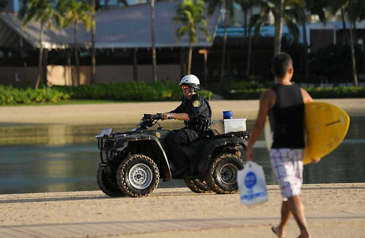 Honolulu police patrol along Waikiki beach as security is beefed up during the Asia-Pacific Economic Cooperation (APEC) leaders' summit on November 12, 2011 in Honolulu, Hawaii. Hawaii's tourist playground of Waikiki Beach braced for an unlikely invasion as security kicked in for a summit of Asia-Pacific leaders hosted by President Barack Obama. AFP PHOTO / Robyn BECK (Photo credit should read ROBYN BECK/AFP/Getty Images)