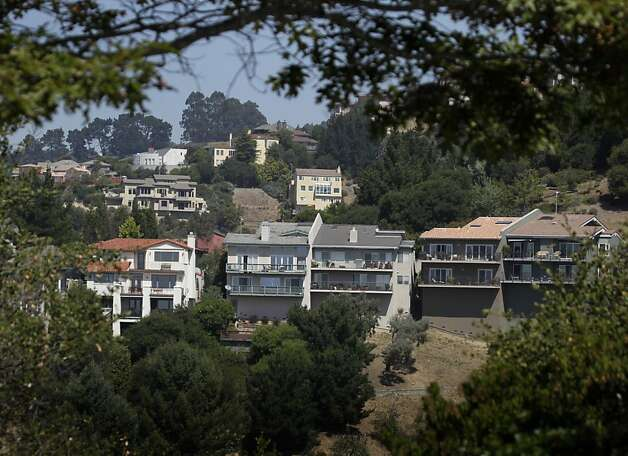 Large homes are seen the Oakland Hills in Oakland, Calif. on Friday, Sept. 2, 2011, where affluent homeowners can claim larger tax breaks from mortgage interest deductions. Photo: Paul Chinn, The Chronicle