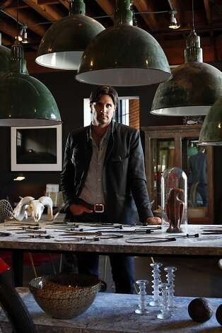 Designer Will Wick owns Battersea, a shop full of curiosities and industrial, masculine furniture and antiques in San Francisco, Calif.  He is photographed in his shop Thursday, July 28, 2011, with some of the store's unique offerings, including a table covered in a collection of calipers. Photo: Sarah Rice, Special To The Chronicle