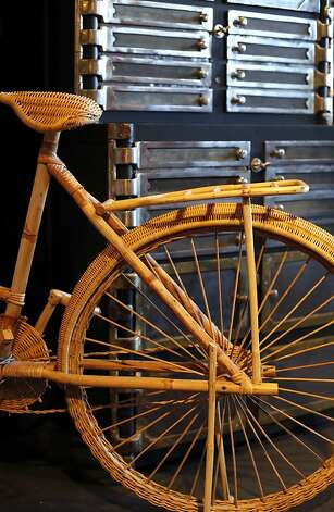 A wicker bike sits in front of a 1940's industrial dental cabinet at Battersea, a shop full of curiosities and industrial, masculine furniture and antiques in San Francisco, Calif. on Thursday, July 28, 2011. Photo: Sarah Rice, Special To The Chronicle