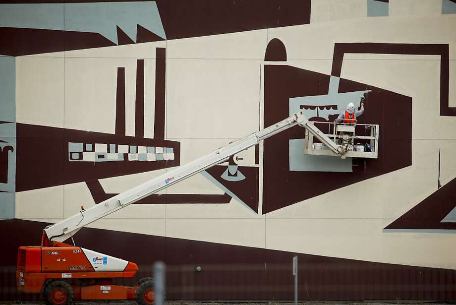 "Brian Barnelco works on a 600-foot panoramic painting called, ""The Systems Mural Project,"" near 7th and Townsend streets on Tuesday, Aug. 30, 2011 in San Francisco, Calif. Photo: Russell Yip, The Chronicle"
